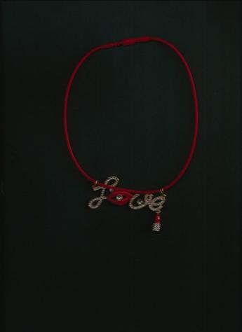 LOVE rhinestones, red lips, red lipstick pendant on a 12-inch red silkie necklace. (dark background)