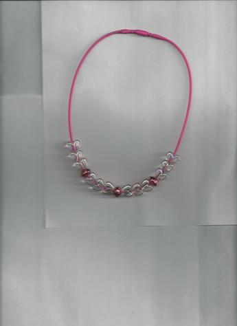 White Transparent Hearts & Metallic Red round beads on a Pink 12-inch silkie necklace. (light background)