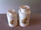 2 CERAMIC MILK CAN SHAPED DAISY CANISTERS