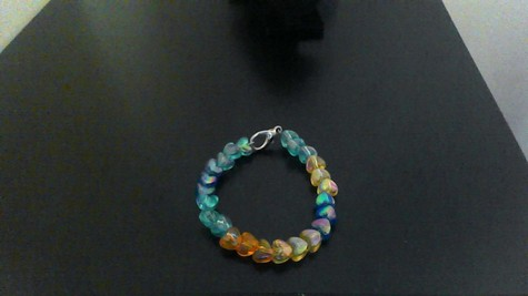 Dark  Blue, Yellow, Light Blue, Orange Transparent Hearts on a Silver-plated Clasp Bracelet.  FUN TO WEAR!