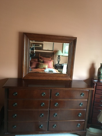 Dresser w/ 8 drawers and matching mirror