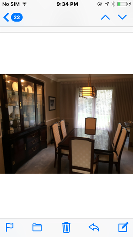 Dining room set table with six upholstered chairs and a China cabinet