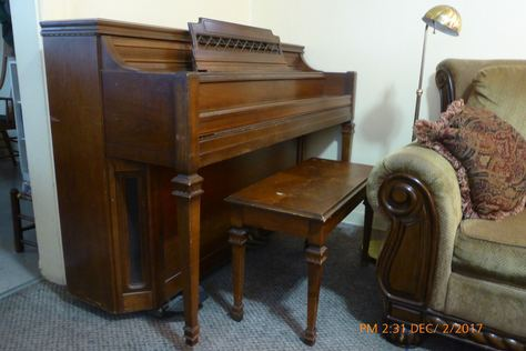 Piano with bench and showing dolly