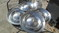 1957  OLDS  HUBCAPS ---4---in good condition