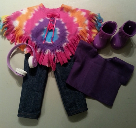 tie-dyed poncho, blouse,skinny jeans, purple fringed boots, headset,