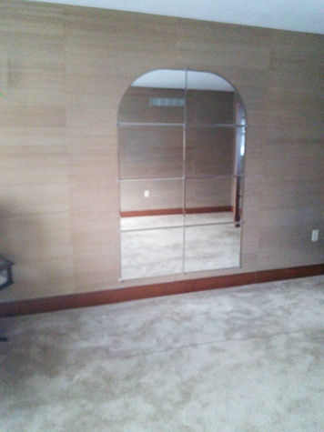 Large wall mirror makes any room appear larger.