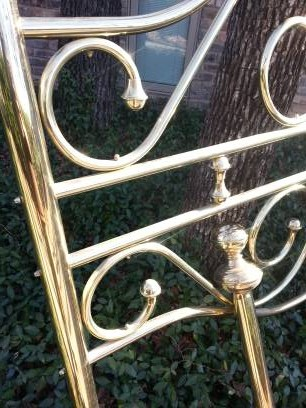 brass bed and foot post closeup