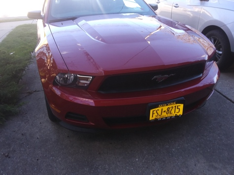 Metalic Red Mustang with 6500 miles.